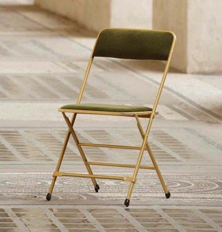 chaise pliante en velours vert